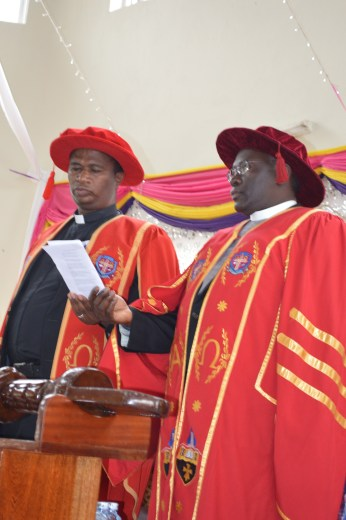 Rugyendo shares the order of service book with the Vice Chancellor, Dr. John Senyonyi