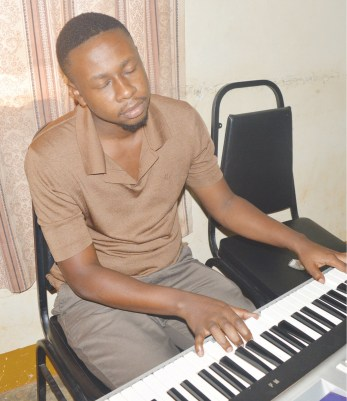 Watuulo plays the piano, right, the drums