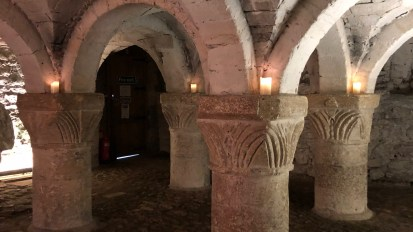 Crypts + candlelight in a Medieval town