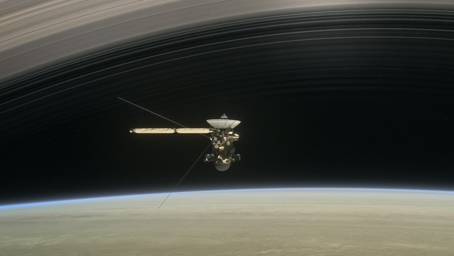 Still from the short film Cassini's Grand Finale, the spacecraft is shown diving between Saturn and the planet's innermost ring.
