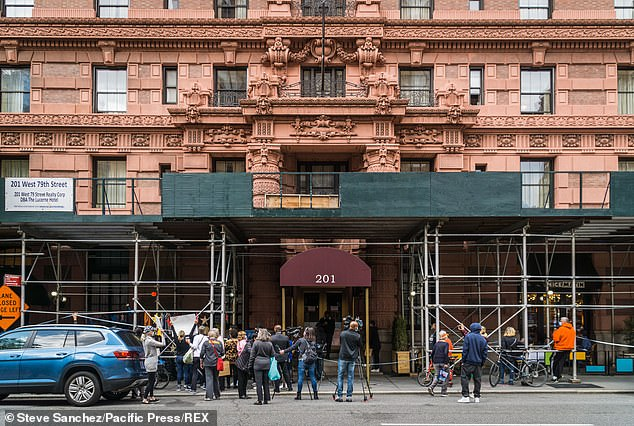 The Lucerne Hotel has been steeped in controversy for weeks since New York City moved roughly 300 homeless men into its empty rooms in an effort to stem the spread of coronavirus. Homeless advocates gathered outside the building on Sunday to show support (pictured)