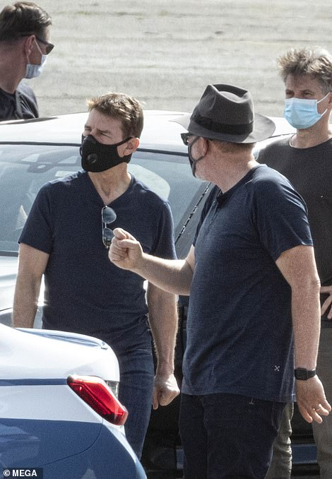 Confident: Tom looked like he was in control as he shot his scenes on the set in Rome on Monday