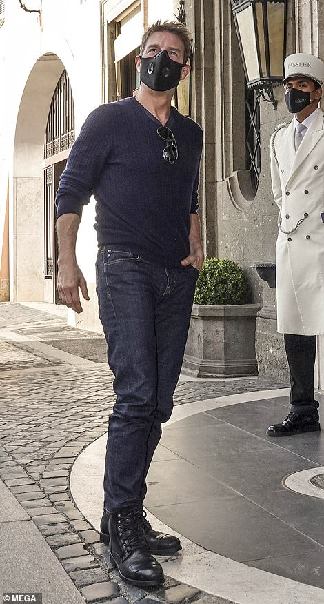 Star:Tom looked casual in a blue jumper and jeans as he left his hotel in Rome before the full day on set, where he was also seen filming a dramatic car chase in a black sports car