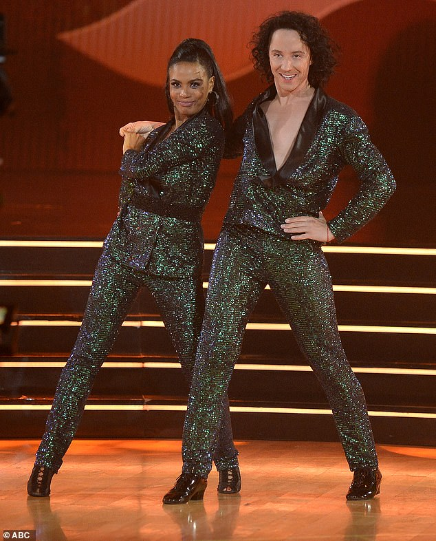 Rocking out: Johnny Weir, 36, and Britt Stewart, 31, grabbed 24 points for their joyous jive to Elton John's Crocodile Rock