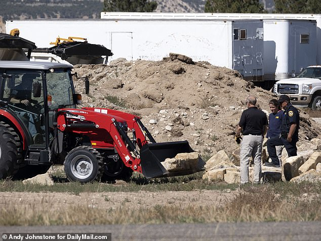Exclusive DailyMail.com photos show FBI and CSI investigators working at the spot where the scent was detected twice by cadaver dogs – once last Sunday and again the following morning