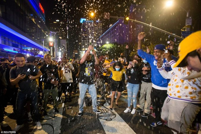 Los Angeles Lakers fans celebrate their team winning the 2020 NBA Championship against the Miami Heat, amid the coronavirus pandemic