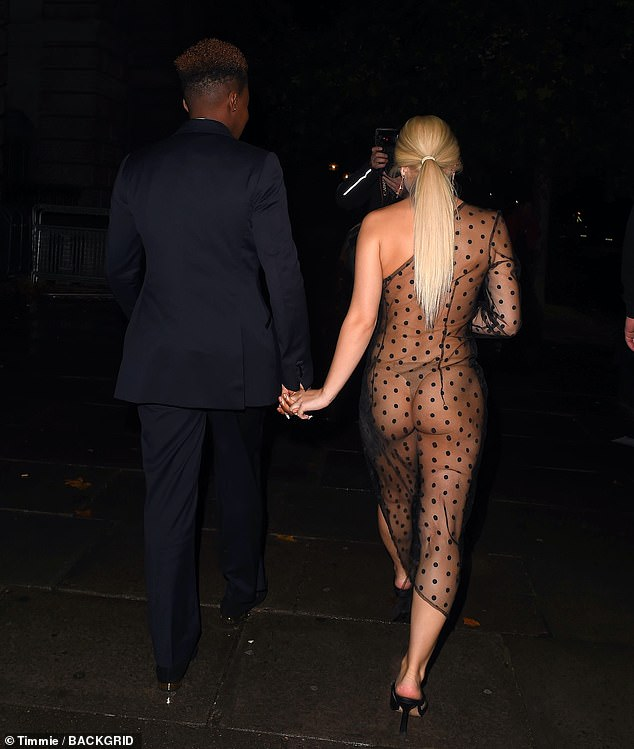 Oh my!She held hands with Ella, who went for a very daring look in a sheer polka dot dress, leaving very little to the imagination