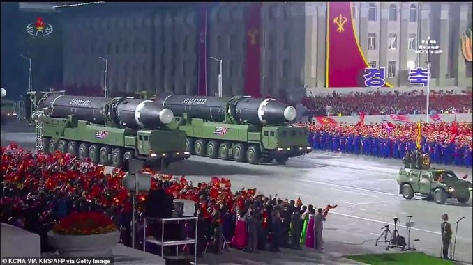A screen grab taken from a KCNA broadcast today shows North Korean Hwasong-12 intercontinental ballistic missiles during a military parade marking the 75th anniversary of the founding of the Workers' Party of Korea, on Kim Il Sung square in Pyongyang