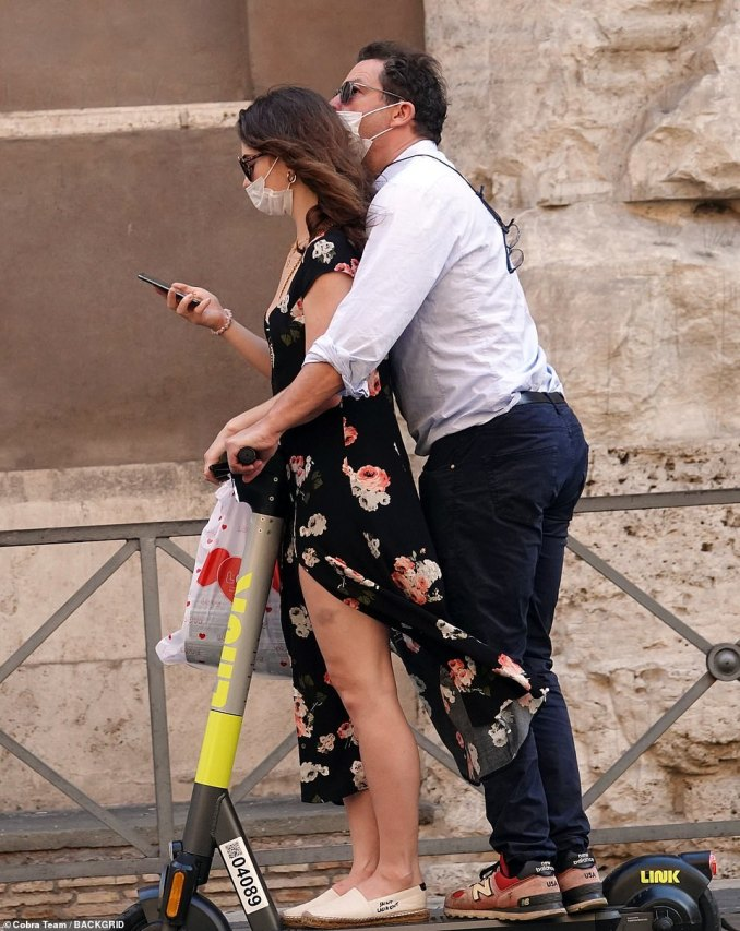 Multi-tasking: She found time to check her phone as she and Dominic took in the sights