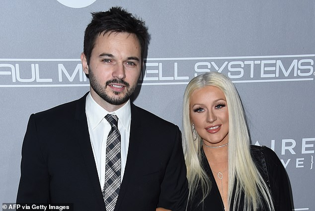 The findings suggest that people search for a mate with the same features just as they do when it comes to finding a mate with the same values and personality traits. Pictured is singerChristina Aguilera and her partner Matthew Rutler, who have been said to have similar features