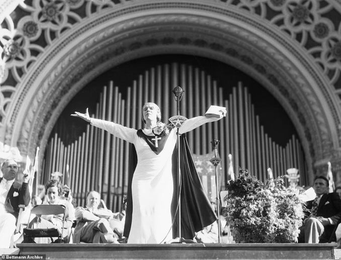 Sister Aimee Semple McPhersontravelling tabernacle eclipsed every theatrical and political touring event in American history between 1919- 1922. Above, she addressees a crowd of 30,000 followers in San Diego in 1921. The Marines were called-in to control the frenzied audience who flocked to see her preach and conduct faith healing performances. She shouted in her frayed, contralto voice to bring forward, 'the worst sinner in San Diego!'