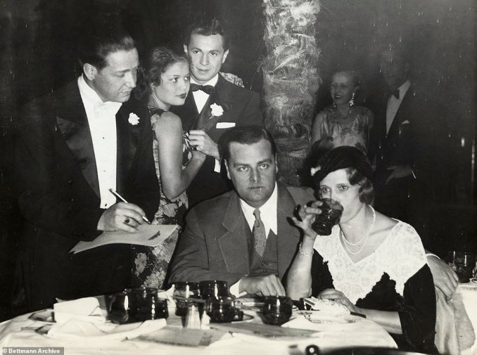 Aimee Semple McPherson sits with her third husband, actor and musician, David Hutton at the Coconut Grove Night Club in Los Angeles. They were married in 1931 and divorced by 1933 after McPherson learned that Hutton was billing himself as 'Aimee's man' in a cabaret singing act and was frequently photographed with scantily clad women