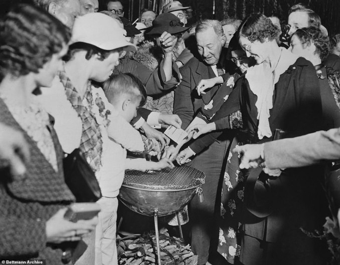 Faithful members of Angelus Temple are shown donating watches, jewels, and money to aid Evangelist Aimee Semple McPherson in her series of legal complications that later dogged her life after she was accused of fabricating her own kidnapping in 1926