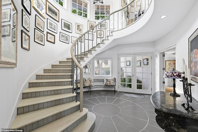 The striking spiral staircase in the entryway adds to the fairytale look at the home with interior design from France's Andrée Putman