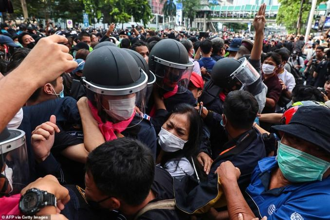 Scuffles broke out between police and activists as some were arrested, a day after an emergency decree was put in place banning gatherings of more than five people