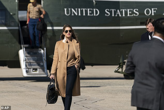 White House officials wanted to keep Hope Hicks' COVID diagnosis a secret after she tested positive for the disease - above she exits Marine One on September 30th - her last trip before her COVID diagnosis