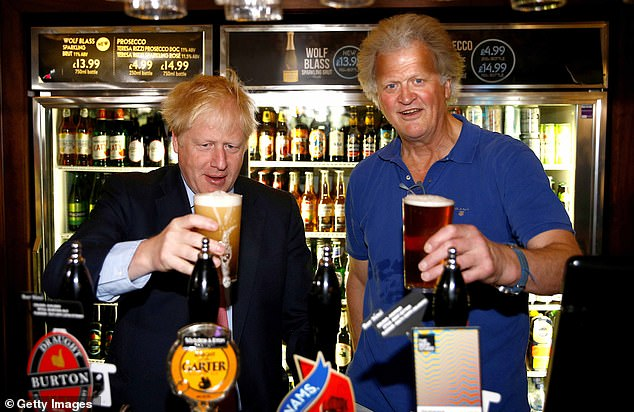 Prime Minister Boris Johnson meets Wetherspoon chairman Tim Martin at the chain's Metropolitan Bar pub in Marylebone, Central London, on July 10, 2019