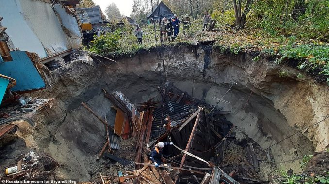 Deputy head of Zlynkovsky district administration, Anatoly Poddubny, said emergency workers were doing everything possible to rescue the pensioner, who is believed to be somewhere inside the sinkhole. 'We still hope for a miracle,' he said