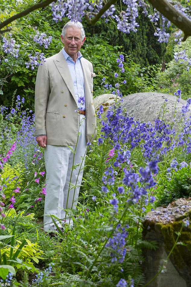 Prince Charles has long-been a passionate advocate for wildlife across the world and recently warned humans have just 10 years left to save the planet (pictured, last year in his own garden at Highgrove)
