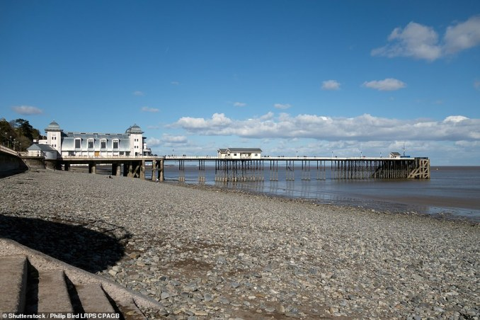 Presumed dinosaur footprints were recently discovered on Penarth beach, pictured, which is south of Cardiff