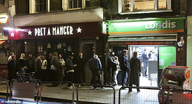 Queues formed for the off licence as revellers carried on the party in borough market on Saturday night when pubs and restaurants closed for the night