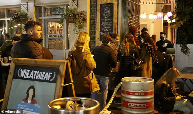 Drinkers queued at the entrance to a pub in Borough Market as revellers took to central London to enjoy a night of drinking despite the restrictions