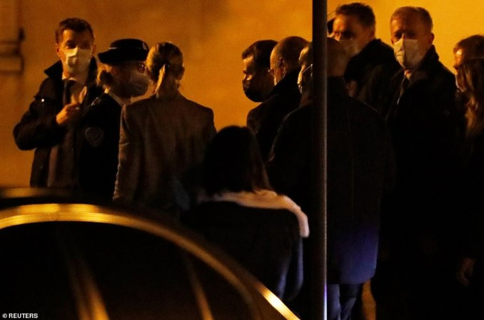 The French President Emmanuel Macron arrives to visit the scene of the stabbing in the Paris suburb of Conflans-Sainte-Honorine