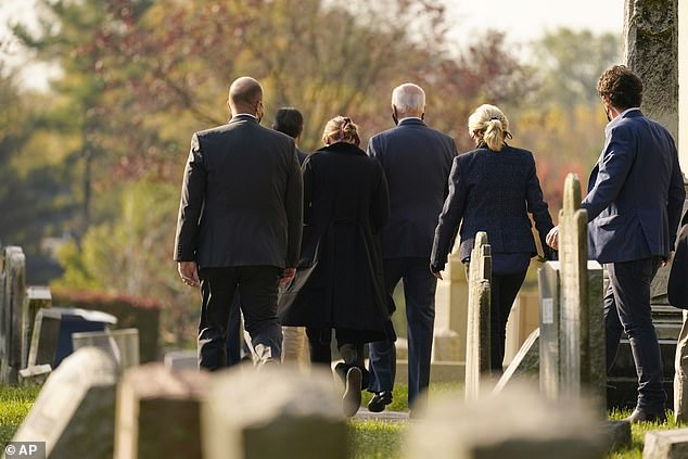Joe Biden (center) leaves mass with wife Jill (second from right) and granddaughter Finnegan (second from left). The Biden family paid their respects to Beau Biden after church services
