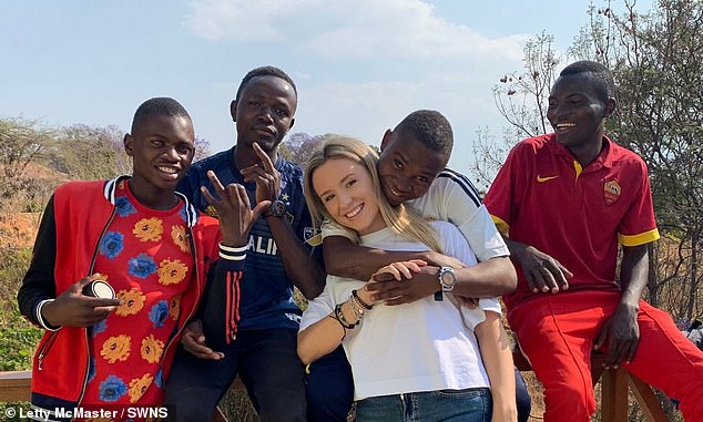 Letty, pictured with some of her boys, said:'I'm just like any mum raising teenagers - I made a commitment to them and I just feel so blessed to have two families'