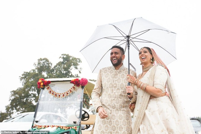 Roma Popat and groom Vinal Patel, both 30, held a drive-in wedding at Braxted Park in Essex. The ceremony way shown on a bid screen before the toured the grounds in a golf buggy (pictured)