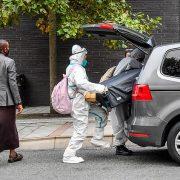 Students arrive at college in hazmat suits