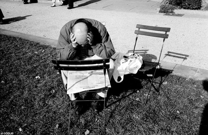 A man deep in thought is snapped reading the newspaper. Unlike fashion or commercial photography, Godlis's aim is to capture the transient micro-stories of everyday people - however mundane or exciting that may be, which is why he says street photography is mostly 'making something out of nothing'