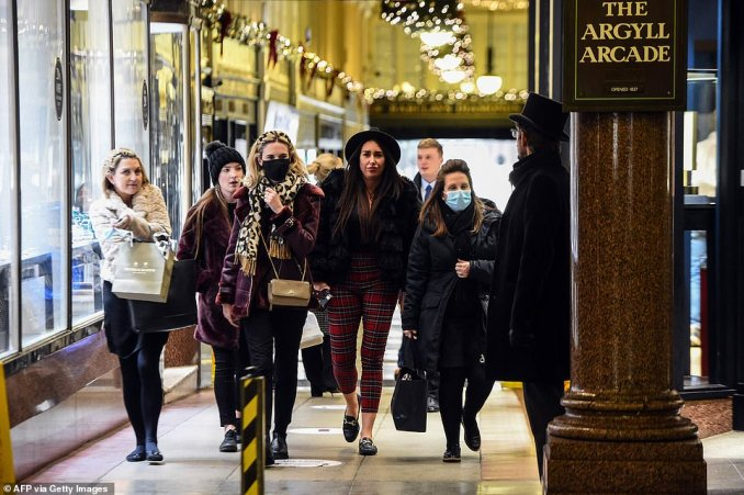 Members of staff leave after the closure of the Argyle Arcade shopping centre on Buchanan Street in central Glasgow, ahead of the introduction of further coronavirus restrictions tonight