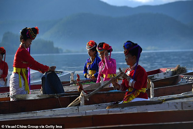 The Mosuo have both matriarchal and patriarchal villages, which were both analysed in the study. In villages which were run by men, 33 per cent of women had high blood pressure, compared to villages run by women, where the figure was 26 per cent (file image of women from the Mosuo tribe)