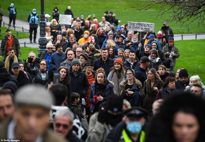Hundreds of anti-lockdown protesters march through the streets of Bournemouth today amid demonstrations across the UK