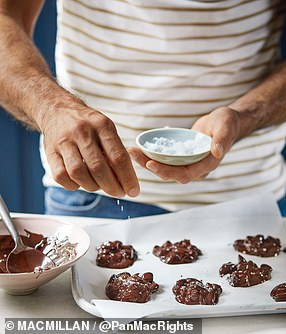 Stir together so that all the almonds get coated in the chocolate, then dollop 10 spoonfuls on to the lined baking trays