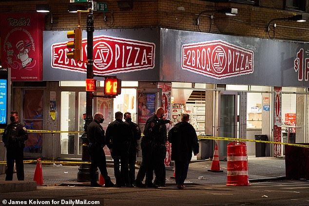 The victim, who is believed to have been in his 40s, was taken to Bellevue Hospital and declared dead at 9.40pm. Cops are seen outside the pizza place after the stabbing