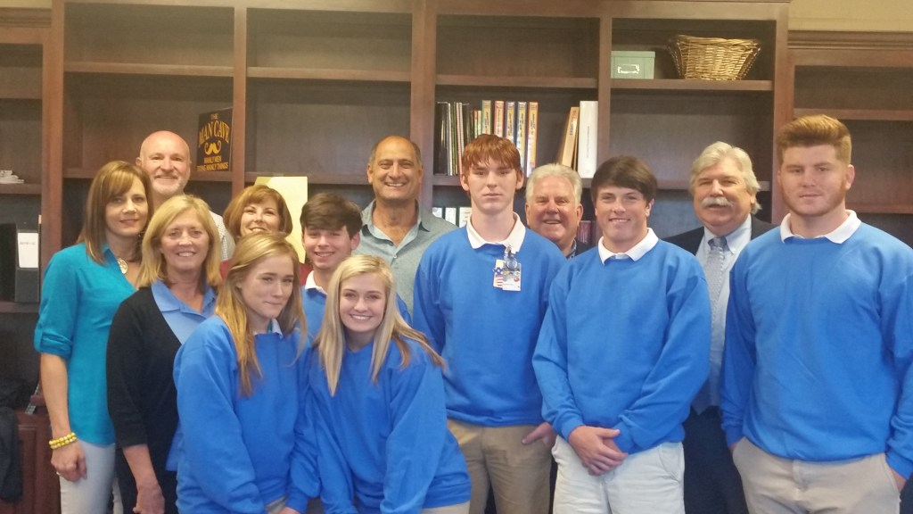 Pictured are the above named members along with the students of Live Oaks High School and Denham Springs High School.