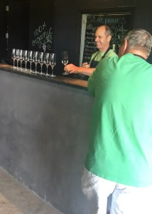 L'Acadie Vineyards owner, Bruce, setting up tasting glasses