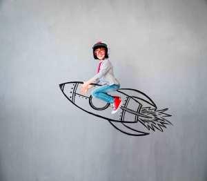 School pupil riding rocket