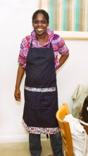 Sada looks a little serious in this photo - her finished Apron!