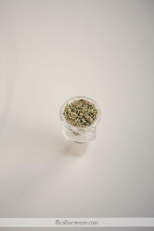 Bowl packed with ground up marijuana