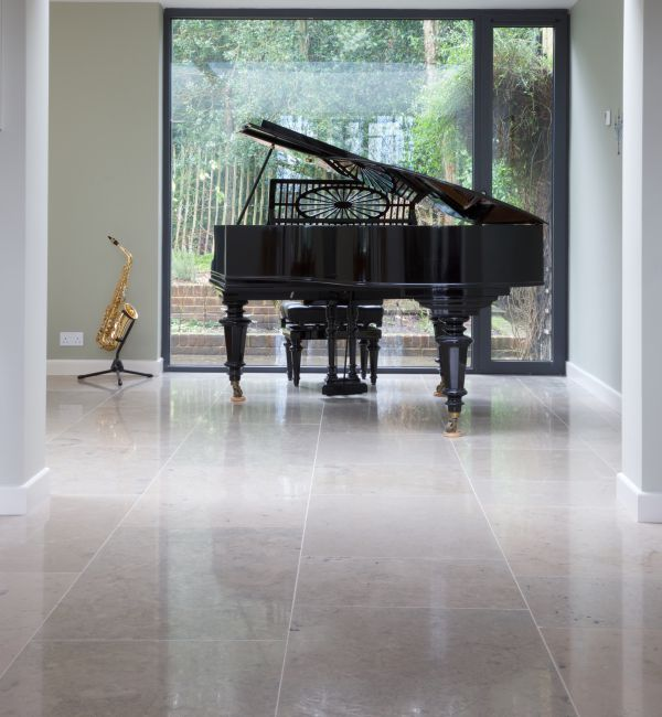 Firmdale Limestone Honed Finish with a grand piano