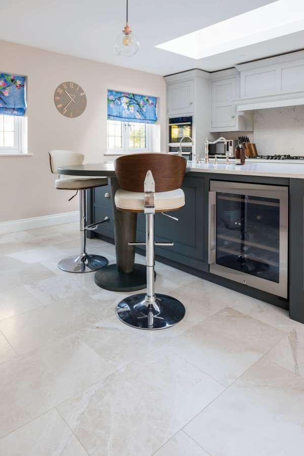 Naturalis Marble Honed Finish complimenting a kitchen serving bar