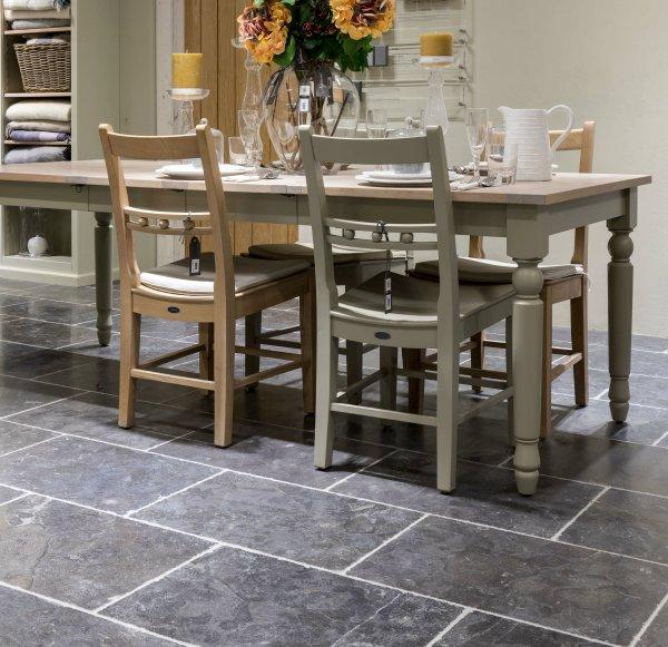 Tamworth Limestone Vintaged Finish under a dining table