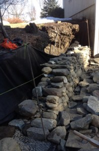 Properly built dry stone retaining wall in progress