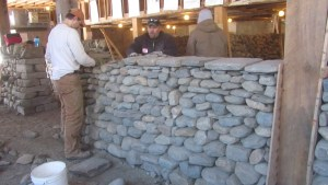 Indoor workshop building dry stone wall
