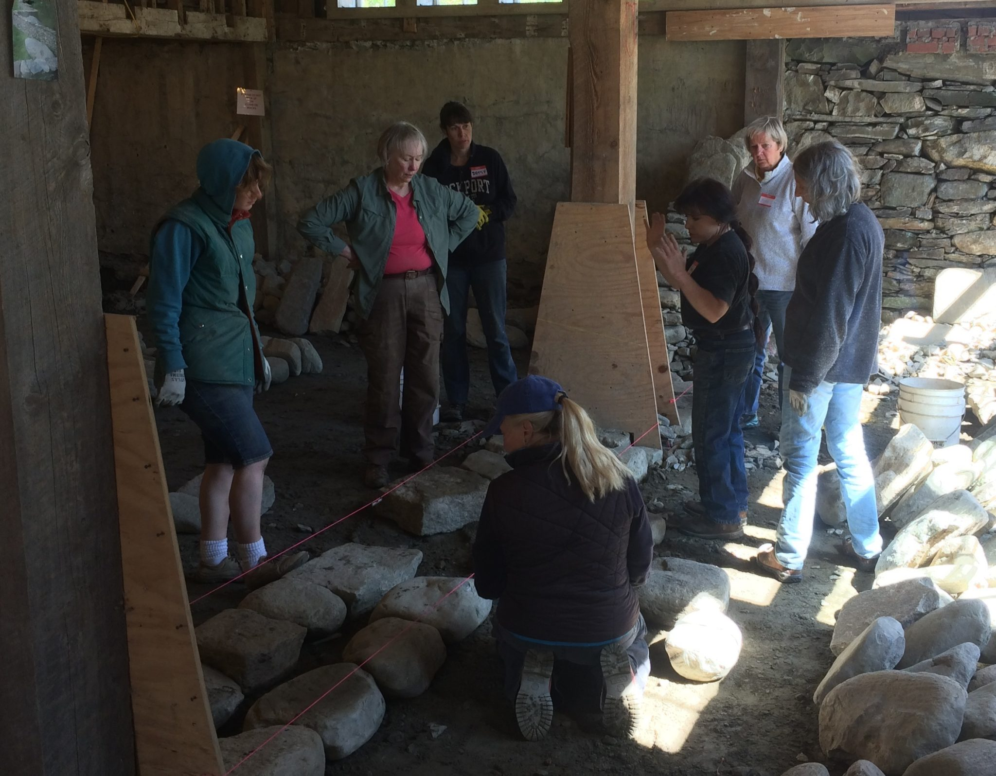 Kim Coggin teaching a dry stone walling workshop at The Stone Trust