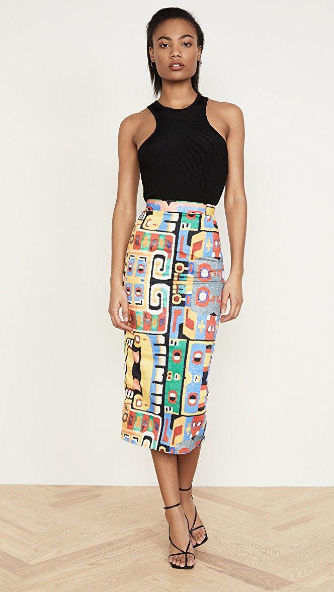 Black female model wearing Stampa Maya Skirt by Stella Jean