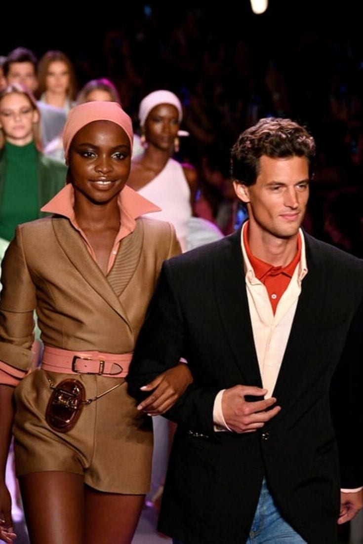 Models wearing menswear trends at Brandon Maxwell Fashion Show showcasing power suits for women, blazer and shorts outfit, menswear fashion women